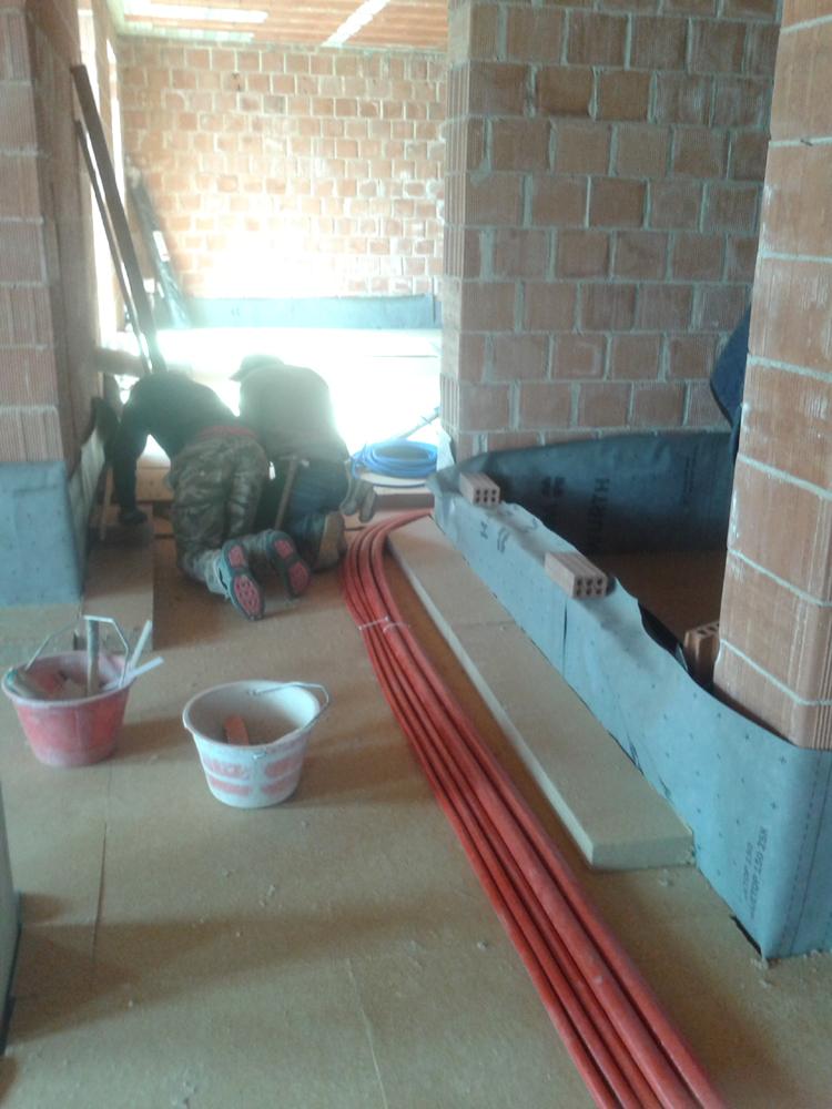 Massetto a secco in cementolegno su isolamento in fibra di legno